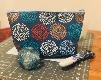 make up/vanity/travel bag. Made with interfacing fabric to provide soft stability. Height 5.5 inches, length 7.5 inches, width 2