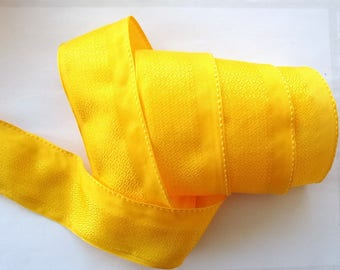 5 meters of fancy color REF 55mm BUTTERCUP yellow ribbon.  1727