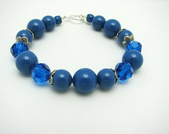 Half off Bracelet SALE. Swarovski Crystals and Blue Glass Pearls Framed w/ Bali Sterling Silver Bead Caps & Sterling Toggle. Classic Jewelry