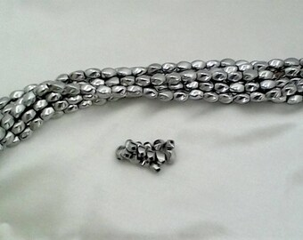 5.10 per strand SILVER TWIST MAGNETIC Hematite beads. 5 x 8 mm silver plated hematite regular strength. Two strands per package