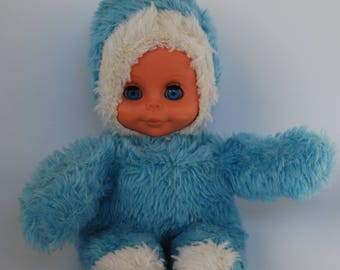 Blue plush doll with sleepy eyes