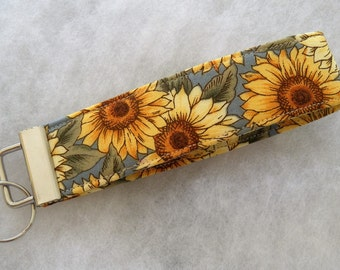 Key Fob wristlet - Sunflowers blue background