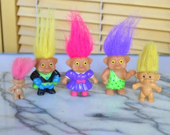 Vintage Trolls Figures with Various Coloured Hair made by Soma China Some Wearing Outfits Ma Caveman Superhero Baby Mini Figs Tiny