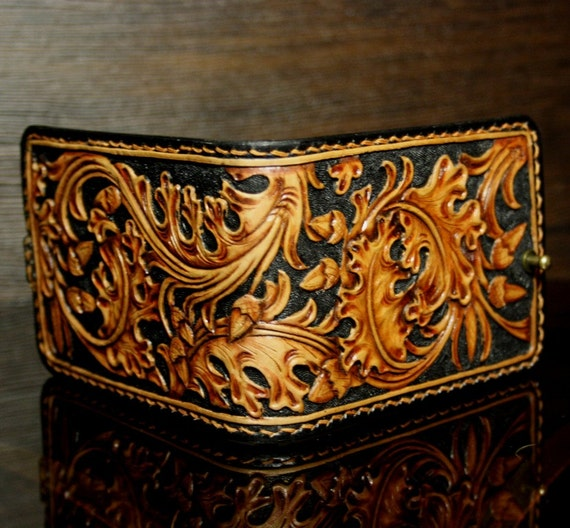 Hand tooled leather money clip with oak leaves pattern