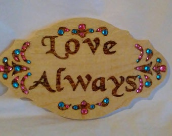 Love Always wood burned plaque with inspirational message, embellished with colored crystals on pine marquee sign.