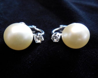 Classic Pearl and Diamond earrings by Coro.  Elegance with a large faux pearl, highlighted by a small clear rhinestone. Classic and elegant.