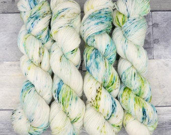 Reducto (Everyday Sock, speckled variegated)- speckles of blue, greens and teal