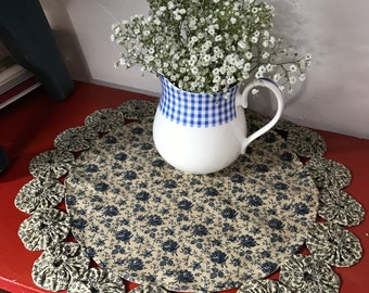 Blue tea-stained yoyo mat adds cottage charm to any room
