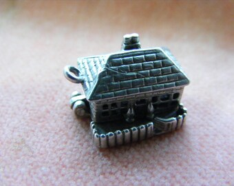 D) Vintage Sterling Silver Charm Cottage opens to the lounge