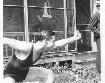"Vintage Photo ""Surprise Attack"" Man Wearing Swimsuit Smoking Cigarette Wields Grapefruit Knife Found Vernacular Photo"