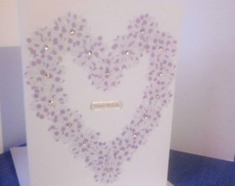 White birthday card with purple heart