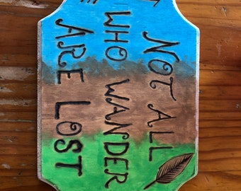 Painted wooden sign with pyrograph letters