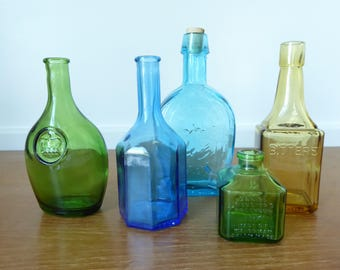 Five colorful Wheaton bottles in excellent condition, 2 3/4 to 6 3/4 inches