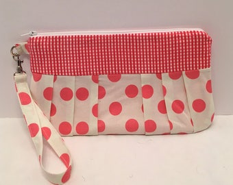 AK4- Compleat Clutch: in a fun polkadot print with pleated front with a zipper closure and detachable hand strap