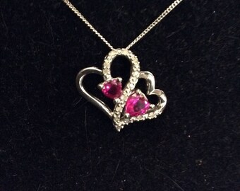 Sterling Silver, Ruby, and Diamond Entwined Hearts Pendant, 925