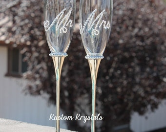 Swarovski Crystal embellished toasting flutes, toasting glasses, champagne flutes for weddings. Brides. Groom. custom. personalized.