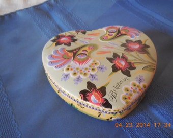 Multi colored flowered Brighton heart shaped tin.