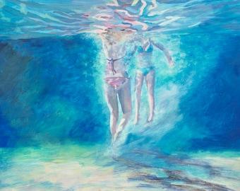 Two underwater swimming girls
