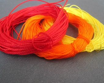 3 x 10 m 0.8 mm weave - red/orange/yellow nylon thread