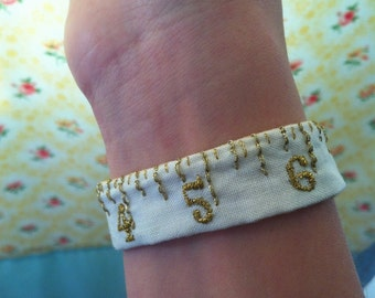 Hand embroidered textile wrist cuff, vintage bracelet, tape measure, gold - jewellery