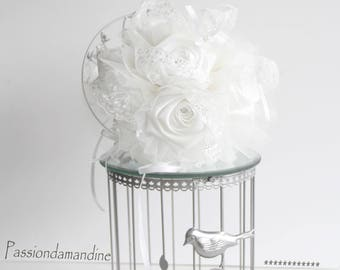 Wedding bridal bouquet made of satin with white lace flowers