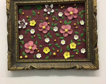 Frame is recycled with ceramic flowers