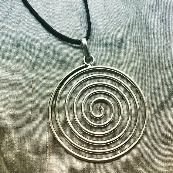 Pachamama spiral pendant necklace on leather cord aloadofball Image collections