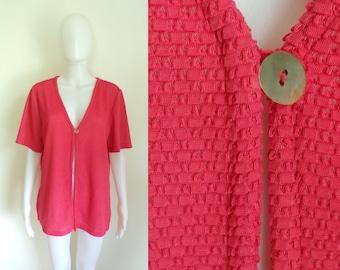 80s knit jacket size medium, salmon pink, lightweight short sleeve jacket, open front, eyelet details, 1980s jacket