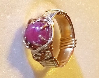 Natural Ruby cab showing a very faint star is  2.5 carats, set on a gold filled band with 7 prongs.  Size 5