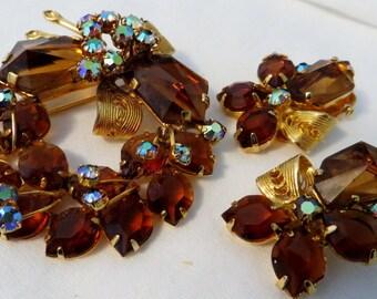 Vintage Rhinestone Australia brooch and clip on earrings demi set smoky topaz A/B rhinestones and gold tone filigree.