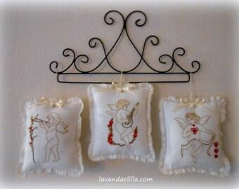 Disegni di quattro angeli