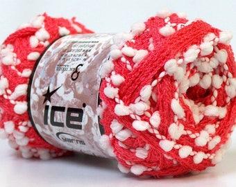 Dark salmon ruffle yarn, small white PomPoms