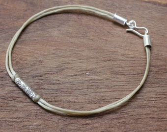Waxed cotton bracelet with sterling silver bead and closure