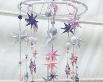 Shimmering and sparkling a nursery mobile for the little one in your life. In pinks and purples, silver and white with depth of character...