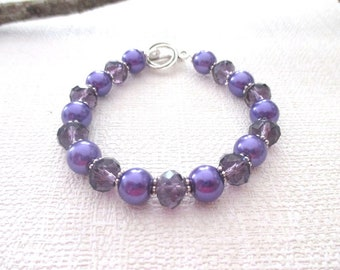 Bracelet glass Pearl and purple faceted beads