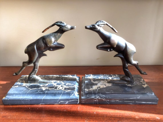 Art Deco style gilt bronze leaping Antelope bookends on marble veined bases