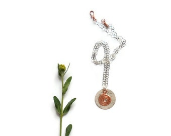 copper spiral necklace // hammered copper and sterling silver jewelry