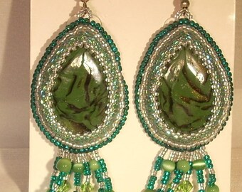 Earrings embroidered on handmade cabochons, green and black tiger Swarovski Crystal pendants