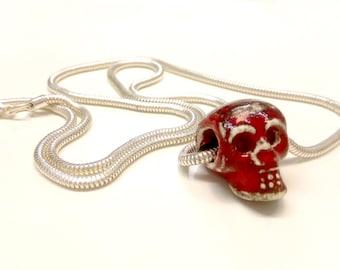 Ceramic skull pendant with silver chain