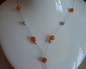 Orange and gray necklace with its tip