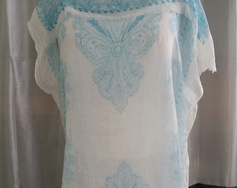 lightweight soft and flowing cover up beautiful light blue, resort or beach.  , can be very dressy or cashual  worn with pants or a skirt