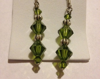 green crystal drop earrings with silver accents