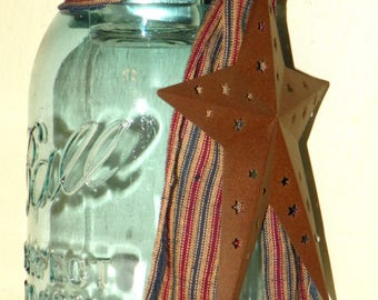 Vintage Mason Jar Candle Holder with a Rusted Star and Tied with Homespun, Blue Tinted Ball Mason Jar with a Rusty Folk Art Star