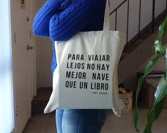 To travel the best ship is a book tote bag