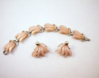 Claudette moonglow bracelet and clip earring set in light pink