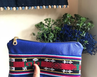 Blue leather clutch bag with handwoven Nepali detail