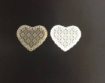 Heart shaped charm in metal - like laces