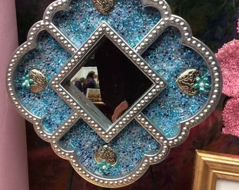 Mirror Silver color with light blue beads. See picture