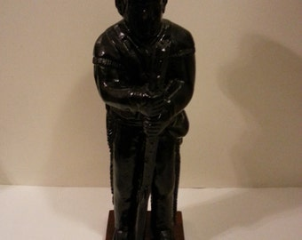 Sculpture of Native Indian Man with Rifle by Stewart Crafts
