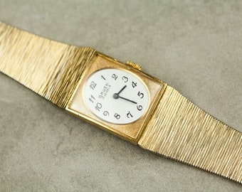 Vintage Gruen Wind Up mechanical watch gold tone case and mesh band with simple shite dial